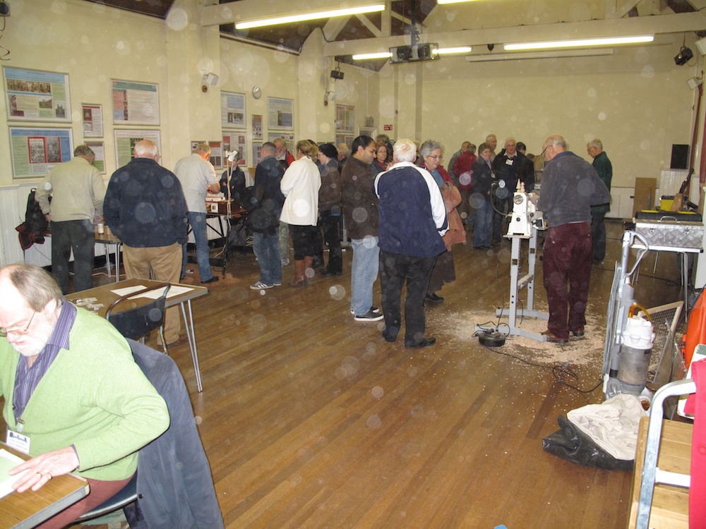A typical evening in the village     		   hall on turning night.