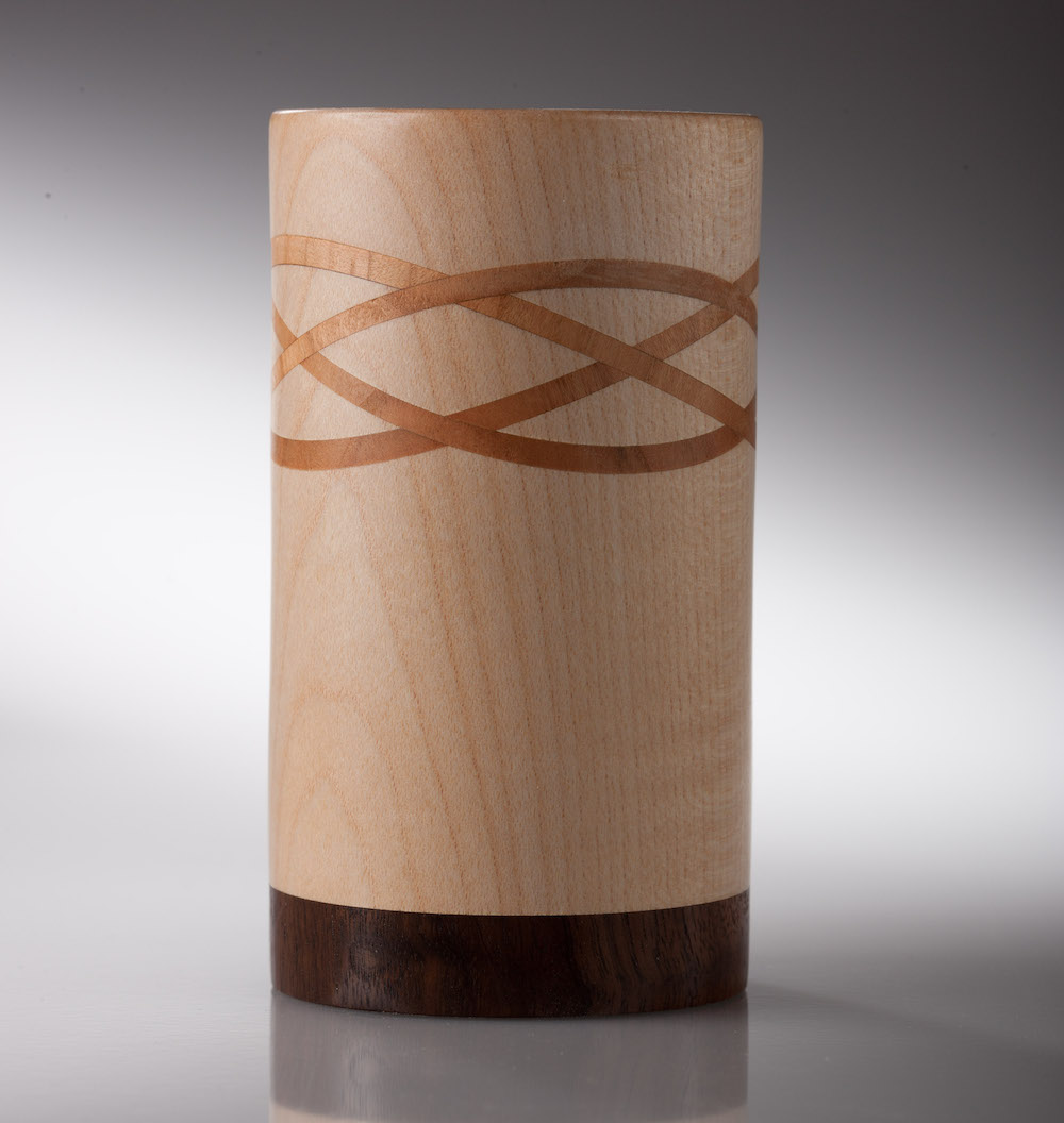 A Sycamore, Cherry and Walnut celtic     		   knot Vase by Graham Hall